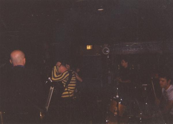 14_On_stage_in_Denver._Right_corner_Eliot_on_drums.