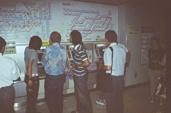 41_Japan._Taka_and_Yoda_give_tourists_directions_in_the_Tokyo_underground