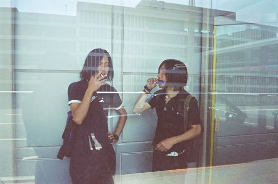 42_Japan._Smoking_area_is_a_glass_cabin_on_the_pavement